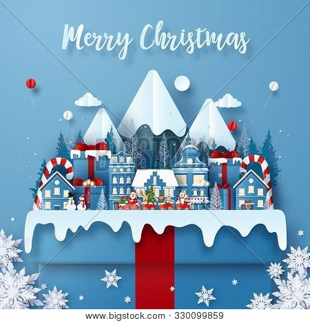 Origami Paper Art Of Postcard Christmas Train In Town On A Big Gift Box With Santa Claus Merry Chris