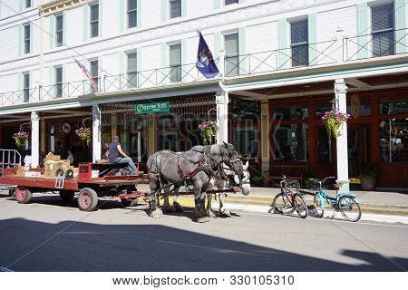 Mackinac Island, Michigan / United States - June 11, 2018: A Horse-drawn Cart Stands In Front Of The