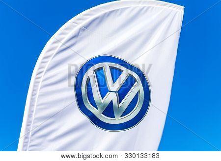 Samara, Russia - October 26, 2019: Dealership Flag Of Volkswagen Against The Blue Sky. Volkswagen Is