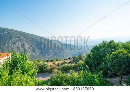View From Famous Town Of Delphi Down To Coastal City Of Itea Over Characteristic Terracotta Tiled Ro