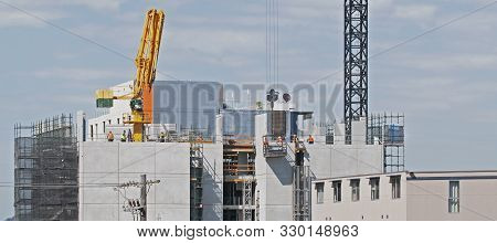 High Rise Building Under Construction. The Structure With Cranes And Blue Sky, Gosford, Australia.