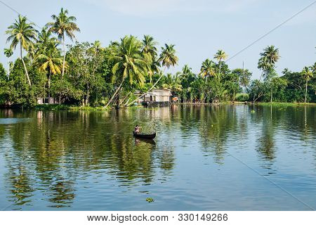 Alappuzha, India - 15 November 2017: Local Indian Man In Small Boat Crossing The River In The Kerala