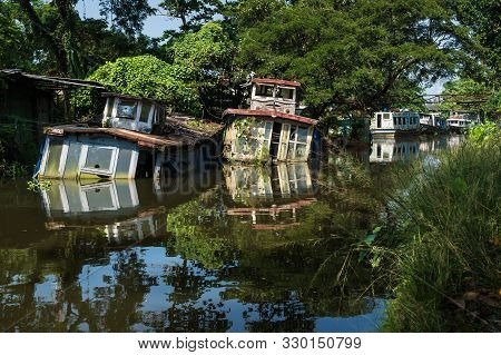 Sunken House Boats With Reflections In The Water In Kerala Backwater Canal, Allappuzha, Alleppey, In