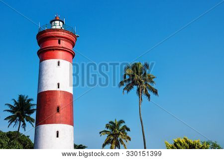 Alleppey Lighthouse With Red And White Stripes With Palm Trees On Cloudless Blue Sky, Aleppuzha, Ker
