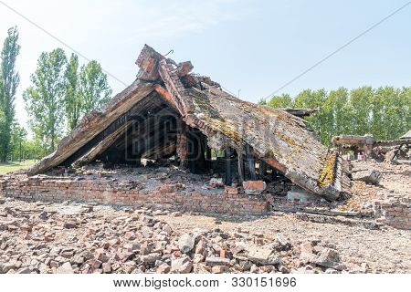 Brzezinka, Poland - July 28, 2019: Blown Up Of Gas Chamber And Crematorium At Auschwitz-birkenau, Fo