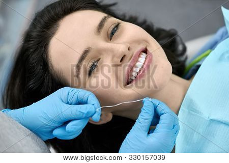 Pretty Womans Teeth Cleaning In Dental Clinic