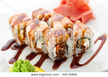 Japanese Cuisine - Sushi Roll with Cucumber, Cream Cheese and Smoked Eel inside. Topped with Shrimp. Garnished with Unagi Sauce poster