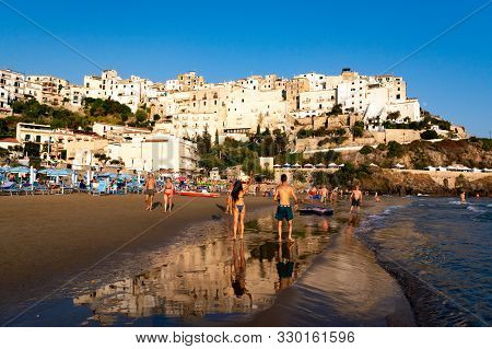 August 12, 2019, Sperlonga, Italy, View On Old Town Sperlonga And Clowded Sandy Beach During August