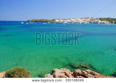 View On The Lagoon With Crystal Water Of Amazing Color The Village Es Grau With White Houses On Meno