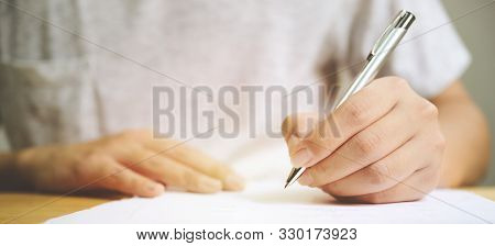 Hand Of Man Signing Signature Filling In Application Form Document Business Contract Agreement