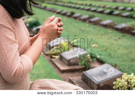 Close-up Of Religious Christian Woman Hands Clasped While Honoring And Praying To Military In War Ce