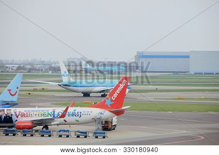 Amsterdam Airport Schiphol  The Netherlands -  April 14th 2018: Corendon And Tui Planes On Tarmac At