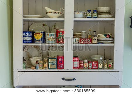 Swift Current, Sk/canada- July 29, 2019: Vintage Containers In Antique Kitchen Cupboard