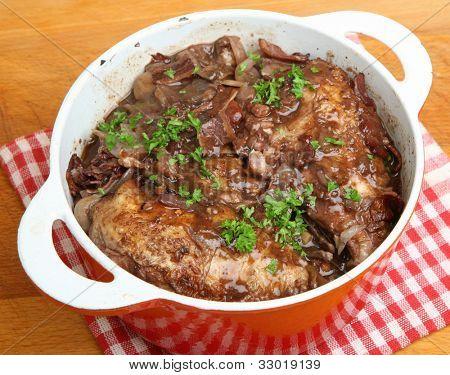Coq au vin, chicken casseroled in red wine.