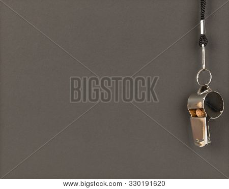Soccer Sports Referee Chrome Whistle On Empty, Blank Blackboard Background With Copy Space