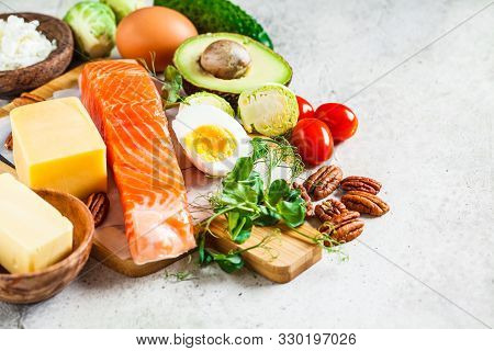 Keto Diet Food Concept. Fish, Eggs, Cheese, Nuts, Butter And Vegetables - Ingredients Keto Diet.