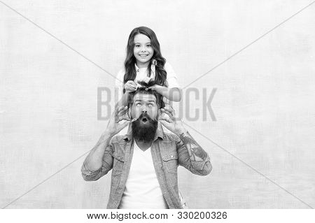 Change hairstyle. Daughter hairstylist. Enjoy fatherhood. Happy moment. Raising girl. Create funny hairstyle. Child making hairstyle styling father beard. Being parent means present for kid interests. poster