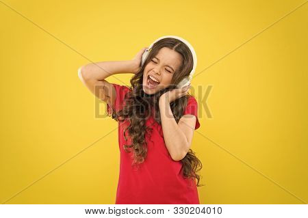 Vocal Music. Cute Little Girl Doing Vocal On Song On Yellow Background. Adorable Small Child Enjoy L