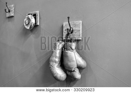 Boxing School. Final Sparring. Vintage Boxing Gloves Hang On Hook Wall Background. Boxing Gloves And