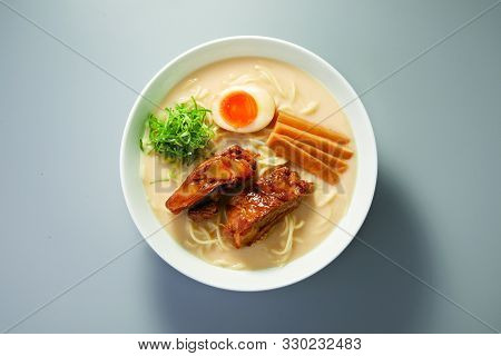 Pork Cartilage Ramen With Bone Soup In A White Ceramic Bowl