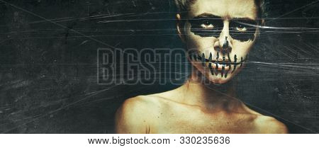 Portrait Of Woman With Halloween Skull Make Up With Space For Text. Horror Spooky Skeleton Visage Co