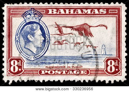 Luga, Russia - October 5, 2019: A Stamp Printed By Bahamas Shows Image Portrait Of King George Vi Ag