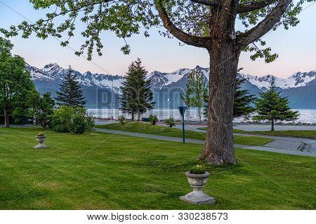 A Park Along The Ressurection Sea In Seward Alaska After Midnight.