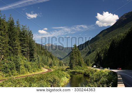 Canada Railroad Line Along Trans-canada Highway In A Valley In Columbia-shuswap Regional District.