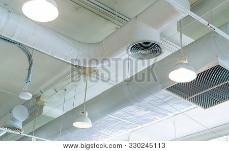 Air Duct, Air Conditioner Pipe And Fire Sprinkler System On White Ceiling Wall. Air Flow And Ventila