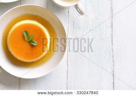 Flan, Caramel Custard Pudding On Plate Over Wooden Background With Copy Space. Top View, Flat Lay