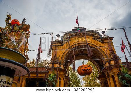 poster of Denmark, Copenhagen: Entrance to the Tivoli park with decorations for the holiday - Halloween
