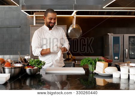 Young Attractive Male Cook Blows Up His Protective Glove Jokes And Has Fun In The Professional Kitch