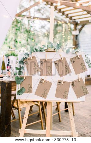 Decorated Seating Plan For Wedding Guests In Woodent Tent Restaurant Outdoors. Original Rustic Woode