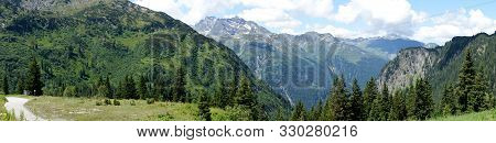 Panorama Of The Alps In Vorarlberg, Austria. View Of Mountain Peaks With Small Snowfields, Steep Roc