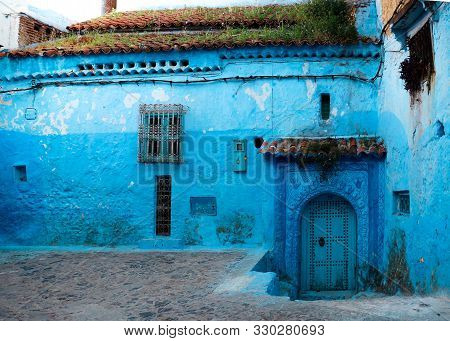 House In The Old Medina Of Chefchaouen, A Small Pretty Town In The Rif Of Morocco. An Artsy, Blue-wa