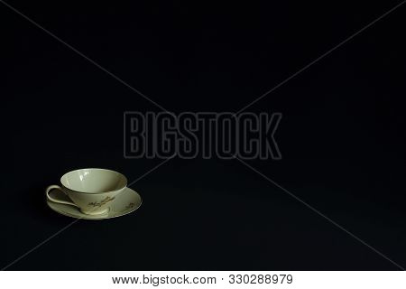 Classic Tea Pair Of Finest Porcelain With Delicate Floral Pattern On Black Background In Minimal Sty