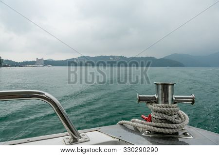 Mooring Post On Small Boat On Beautiful Green Water