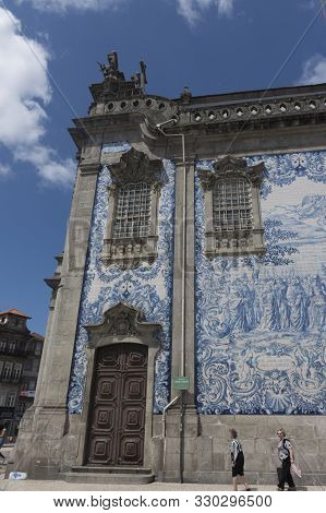 Porto, Portugal - July 20, 2017: Side Facade Of The Church Of Carmo, Painted Tiles, Scene Designed B