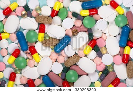 Medical Background With Different Pills. Pharmaceutical Medicine Pills, Tablets And Capsules Differe