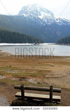 Empty bench at Crno lake and Durmitor mountain in Montenegro poster