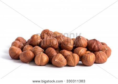 Hazelnuts Without Shell On A White Background, Isolated. Pile Of Hazelnut Closeup