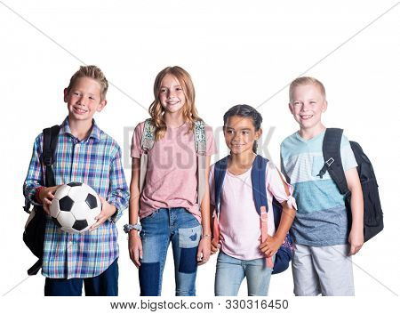 Group of Elementary school students smiling and hanging out together after school. Isolated on a white background