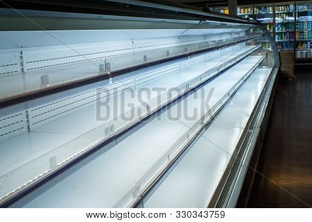 Empty Shelves In Store. Supermarket With Empty Shelves For Goods.