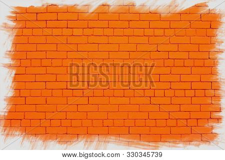 Orange Brick Wall With Jagged White Frame.