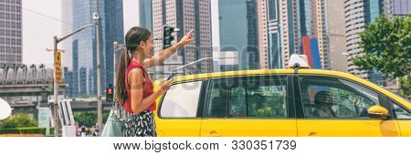 Taxi cab mobile phone app Asian business woman walking on street hailing a car for a ride using smartphone panoramic banner. City commuter lifestyle.
