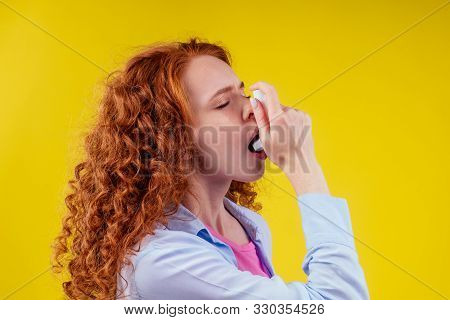 Upsad Redhead Curly Ginger Tourist Student In A Blue Shirt Having Asthma Using The Asthmas Inhaler F