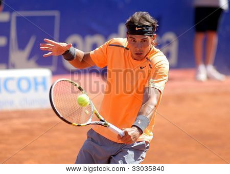 BARCELONA - APRIL, 26: Spanish tennis player Rafael Nadal in action during his match against Robert Farah of Barcelona tennis tournament Conde de Godo on April 26, 2012 in Barcelona
