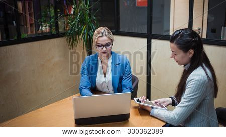 Young Hr Woman Interviews A Candidate For A Job. Business Meeting Two Young Women At Work Discussing
