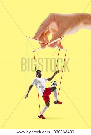 Man Like A Puppet In Somebodies Hands On Yellow Background. Concept Of Unfair Manipulation, Phycolog