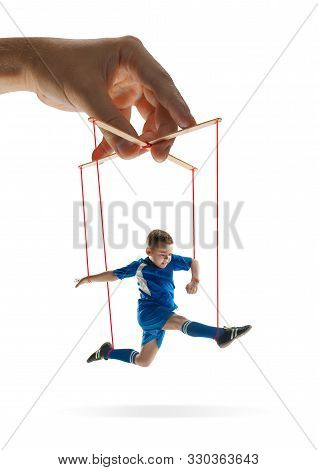 Boy Like A Puppet In Somebodies Hands On White Background. Concept Of Unfair Manipulation, Phycology